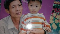Nguyen Duc Tan, 58, poses for a photo with his grandson Nguyen Duc Long in this file photo. Photo: Ai Chau