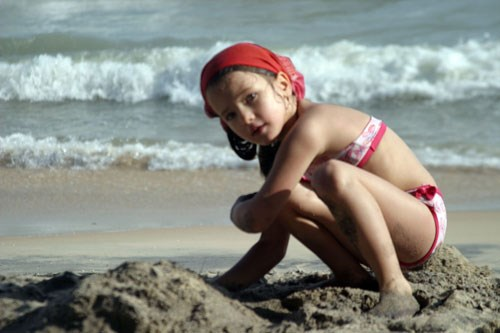 A Russian girl plays with sand at Mui Ne beach in south-central Vietnam. Photo: Que Ha