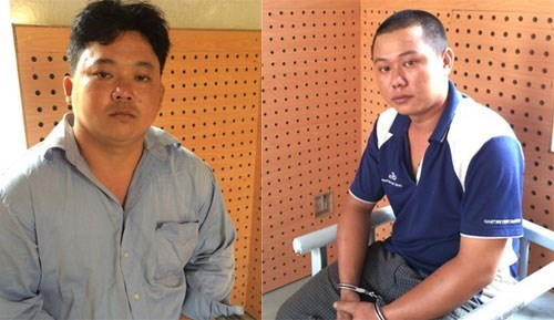 Lam Thai An (L) and Nguyen Thanh Dat at the police station. Photo: Phuong Ha