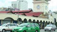 Three taxis in front of Ho Chi Minh City's iconic Ben Thanh Market