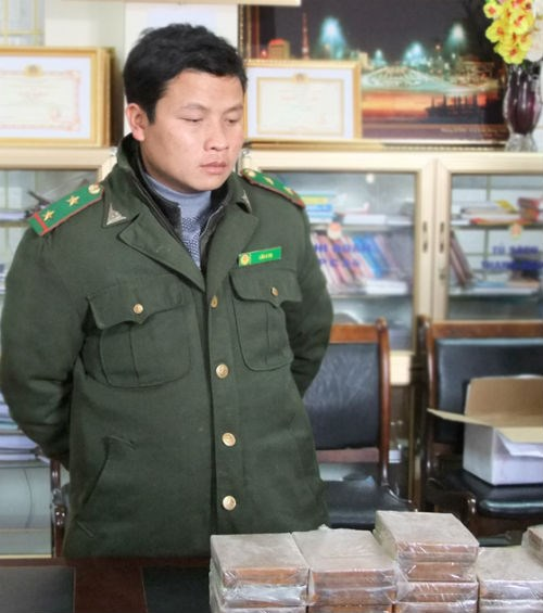 Park Ranger Lau A Su was arrested while smuggling over 10kgs of heroin. Photo credit: Lao Cai Online