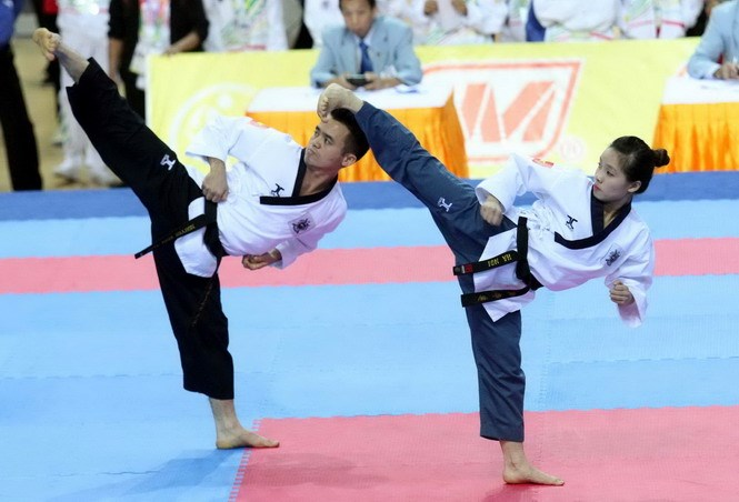Taekwondo athletes performing at the Vietnam National Games 2014. Photo: Kha Hoa