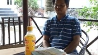 Vo Van Minh was arrested while receiving money from the company on January 27. Photo credit: Tien Giang police