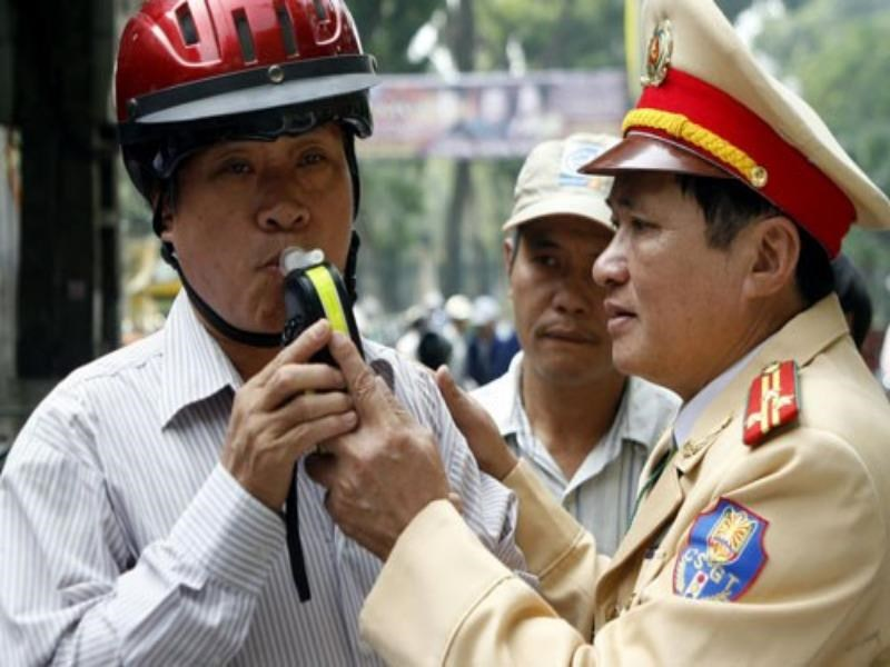 Police test a motorbike driver in Hanoi for alcohol. Photo: Ngoc Thang
