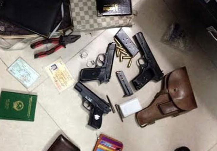A file photo provided by the police shows guns and tools to steal ATMs that Hanoi police seized from Tran Dang Dai.