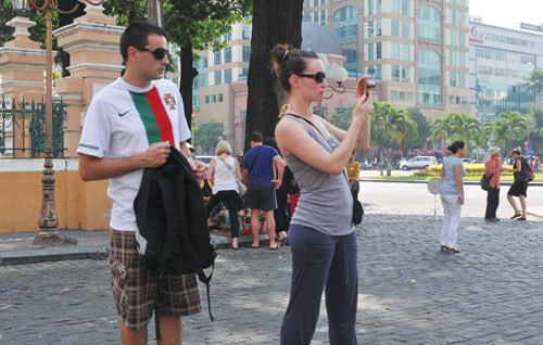 Foreign tourists taking picture in downtown Ho Chi Minh City. Photo: Diep Duc Minh