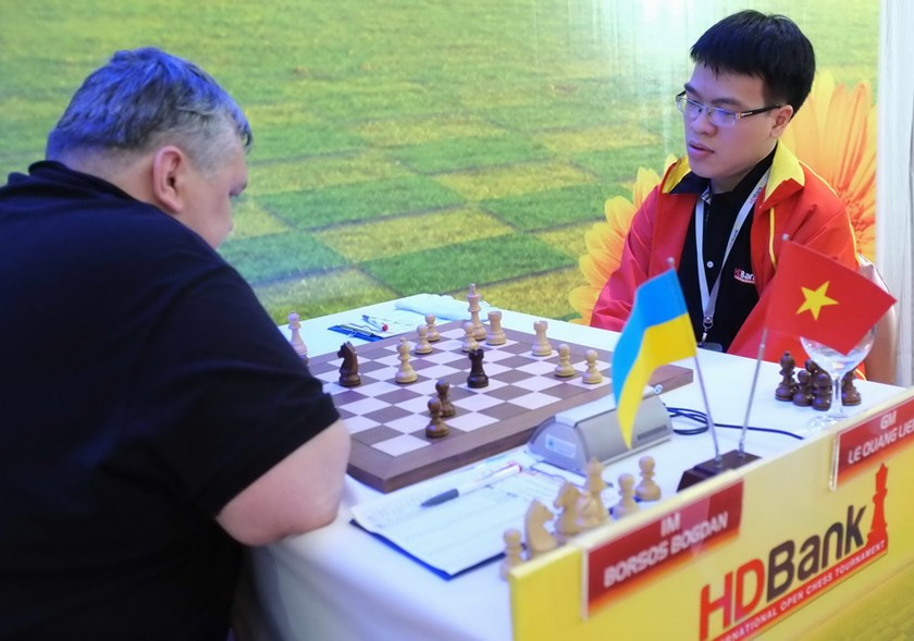 Vietnam's Le Quang Liem (R) plays against Ukraine's Borsos Bogdan at the 2014 HD Bank Cup International Open Chess Tournament in Ho Chi Minh City. Photo: Bach Duong