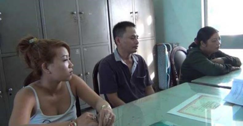 (L-R) Huynh Thi Trung, Do Cao Loc and Dinh Thi Thanh at the police station. Photo: Cong Nguyen