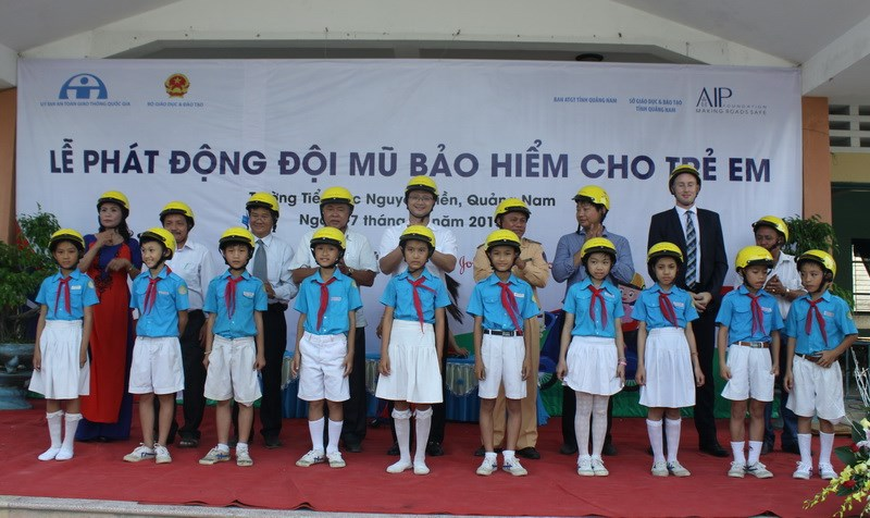 Children in Quang Nam Province receive free helmets from the Asia Injury Prevention Foundation's Helmets for Kids program. Photo credit: AIP Foundation