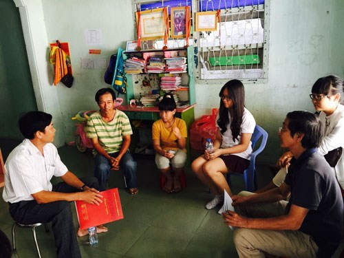 The Canadian International School System staff visit P (third from left) at her house in Tra Vinh Province. Photo: TQD