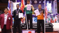 Nguyen Bao Thai on the podium for a gold medal in men's 45kg in Pencak Silat at the 1st World Martial Arts Council Games in Thailand. Photo: Tri Thien