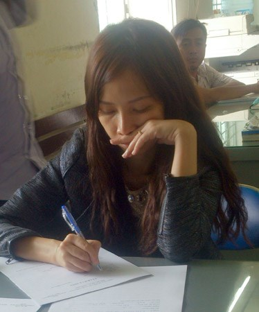 Le Thi Phuong Trang at the police station. Photo credit: CAND