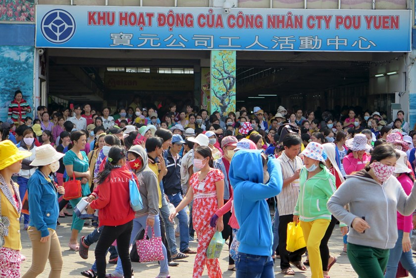 Workers of Pou Yuen Vietnam gather at their factory on the fifth day of a strike in Vietnam's southern Ho Chi Minh City March 31, 2015.