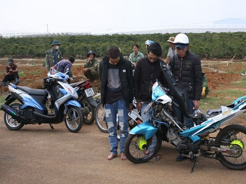 Three men being arrested while racing on the Cam Ly Military Airport in Da Lat Town. Photo: Lam Vien