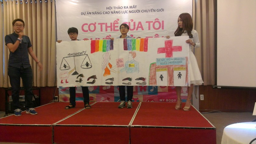 Four transgender people displaying a banner calling for medical services and no discrimination to transgender people in Vietnam. Photo: Minh Hung