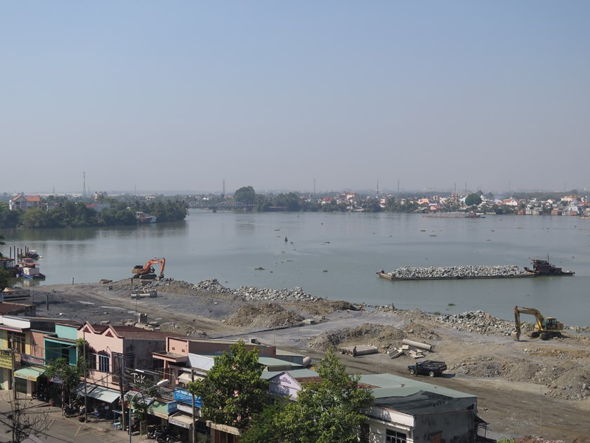 Materials are dumped into the Dong Nai River to fill a part of it for a development. Photo: Dao Ngoc Thach