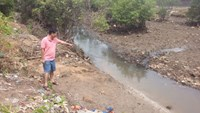 A man points at the stream in Ba Ria Vung Tau Province where four children drowned on May 19. Photo: Nguyen Long