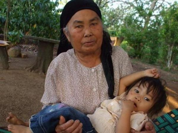 A 84-year-old woman with her great-grand daughter. Experts have urged Vietnam to improve social welfare for older people as Vietnam's population is aging rapidly. Photo: Minh Hung