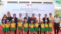 Children at the October 20 Kindergarten in Hanoi receive free helmets on May 27. Photo credit: AIP Foundation