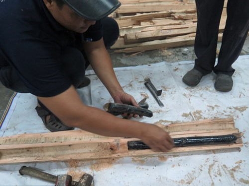 Cocaine has been hidden in wooden pallets in a container shipped from South America to Vietnam. Photo: Dam Huy