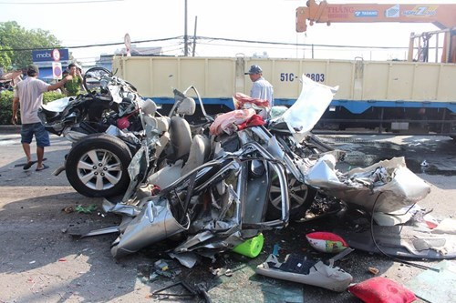 The car that was crushed by a container truck in an accident in Ho Chi Minh City on May 31. Photo: Duc Tien