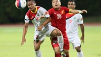Vietnam's Phi Son vies for the ball with a Timor-Leste player in a Group B match at the 28th South East Asian Games in Singapore on June 7, 2015