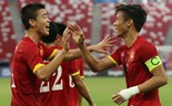 Vietnam's Do Duy Manh (L) and Que Ngoc Hai celebrate scoring their fifth goal SEAGAMES28. Photo credit: Singapore SEA Games Organizing Committee / Action Images via Reuters