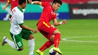 Wawan Pebriyanto of Indonesia (L) competes for the ball against Tran Phi Son of Vietnam during the men's football bronze medal match at the 28th Southeast Asian Games (SEA Games) in Singapore on June 15.