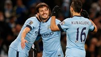 David Silva celebrates with his teammates after scoring a goal for Manchester City