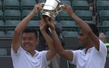 Vietnam's Ly Hoang Nam and Sumit Nagal of India celebrates their Wimbledon boy's double title on July 12.