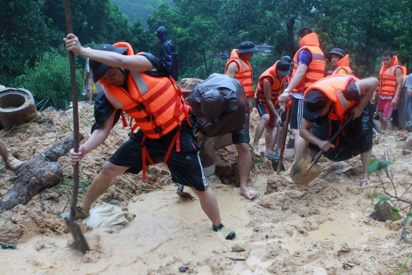 Soldiers search at a landslide site caused by violent floods in Ha Long Town in the northern province of Quang Ninh on July 28. At least 17 people have been killed in the worst flooding for 40 years in Vietnam's northern Quang Ninh province, home to the UNESCO-listed Halong Bay tourist site. Photo: AFP