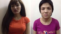 Two women at a police station after being caught snatching an iPhone from a British tourist in Ho Chi Minh City on August 13, 2015. Photo credit: VnExpress