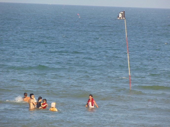 Tourists swimming near a warning flag in Vung Tau. Photo: Minh Anh