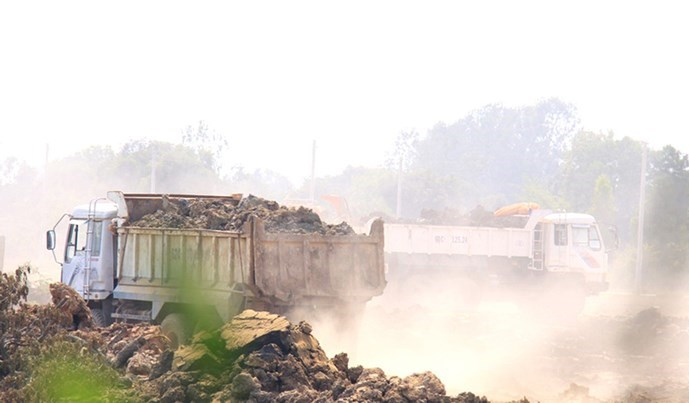 Trucks filling land at a site to build the Moc Hoa Area General Hospital in Long An Province. Photo: Hoang Phuong