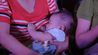 A mother breastfeeds her baby at an event to promote breastfeeding in Ho Chi Minh City. Photo: Minh Hung