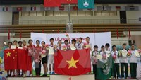 Vietnam athletes on the highest podium at the award ceremony of the World Shuttlecock Championships in Italy. Photo: VNA