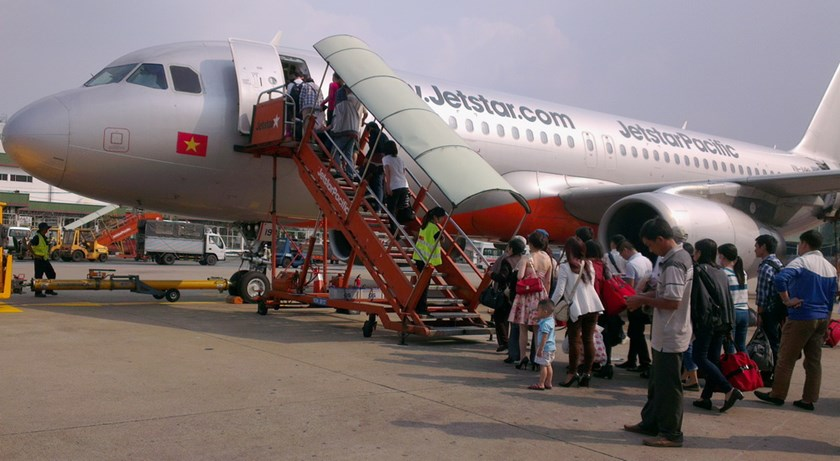 Passengers boarding a flight at the Ho Chi Minh City's Tan Son Nhat Airport. Photo: Minh Hung