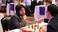 Le Quang Liem (R) and Hikaru Nakamura at the second edition of the Millionaire Chess Open tournament in Las Vegas. Photo credit: Millionaire Chess