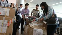 Tan Son Nhat International Airport officers record a case of a piece of baggage being tampered with on June 11. Photo credit: Tuoi Tre