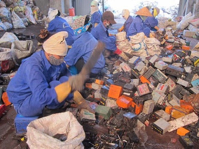 A file photo shows Dong Mai villagers recycling lead from used batteries. These facilities have been relocated outside the village but lead pollution remains in the northern village. Photo: Ha An
