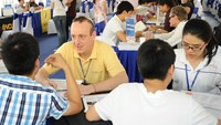 Vietnamese students being consulted at an education fair held by Education USA. Photo credit: US Consulate General