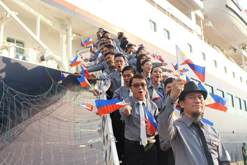 The Philippine delegate performs a flag cheer while getting ashore from the youth exchange ship Nippon Maru at the Ho Chi Minh City's Cat Lai Military Port on November 17, 2015. Photo credit: Ho Chi Minh Youth Union