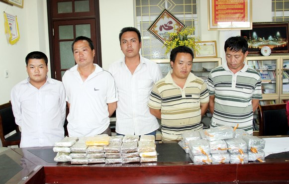 Five of the suspected smugglers at a police station in the northern province of Lao Cai. Photo credit: Ngoc Trien/Dan Tri
