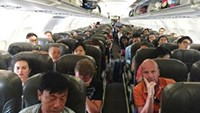 Passengers onboard the Jetstar Pacific flight from Phu Quoc to Ho Chi MinH City on December 25, 2015. Photo credit: VTC