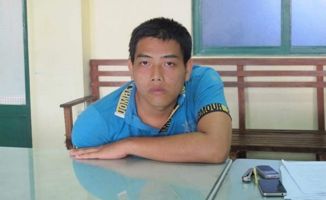 Kien Hoang Minh, 21, at the police station. Photo credit: Duc Thanh/Tuoi Tre