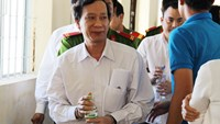 Nguyen Trung Tam, 44, was escorted out of the trial on Thursday. Photo: Gia Bach