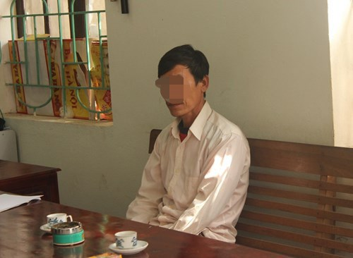Le Ba Thuan at a Nghe An Province's police station. He has been fined for slaughtering six monkeys. Photo: Pham Duc