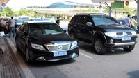 Two state-owned cars parking at Ho Chi Minh City's Tan Son Nhat Airport. Photo credit: Huu Cong/VnExpress