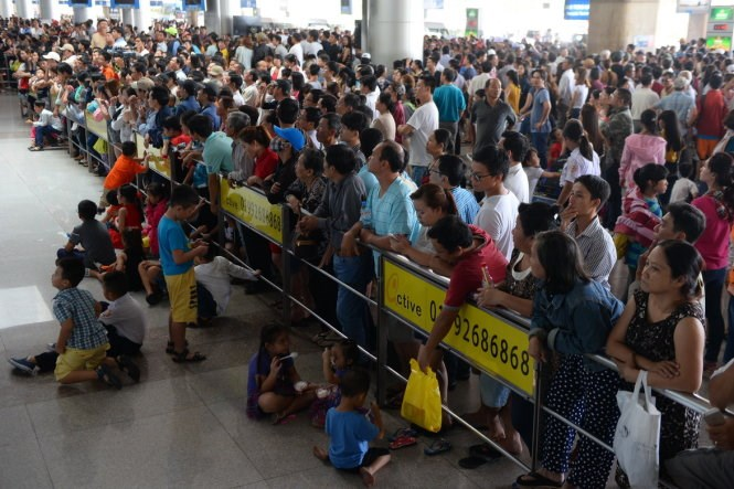 People wait for relatives and friends at Ho Chi Minh City's Tan Son Nhat International Airport. Photo credit: Huu Khoa/Tuoi Tre