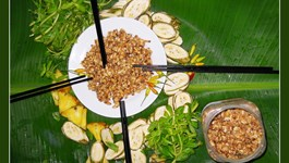 Fermented bee larvae is often served with vegetables in the Mekong Delta. Photo: Gia Bach